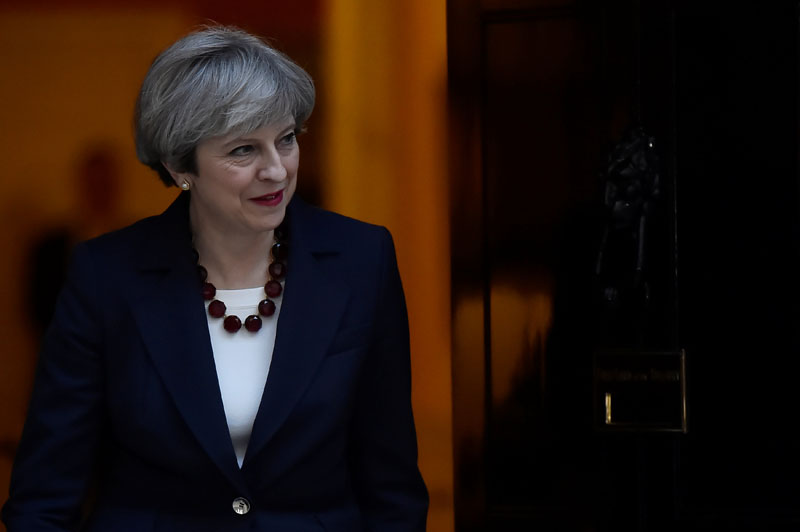 Britain's Prime Minister Theresa May walks out of 10 Downing Street to welcome Head of the European Commission, President Jean-Claude Juncker to Downing Street in London, Britain on April 26, 2017. Photo: Reuters