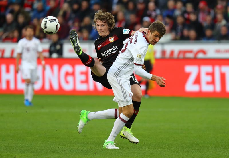 Bayer Leverkusen's Tin Jedvaj in action with Bayern Munich's Thomas Muller. Photo: Reuters