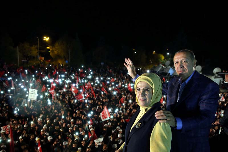 Turkish President Tayyip Erdogan, accompanied by his wife Emine Erdogan, addresses his supporters in Istanbul, Turkey, on late April 16, 2017. Photo: Yasin Bulbul/Presidential Palace/Handout via Reuters