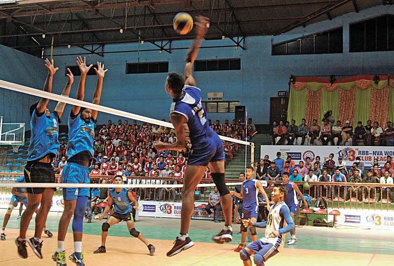 A Tribhuvan Army Club player jumps for a spike against Help Nepal Sports Club during their RBB-NVA Club League Volleyball Tournament match in Kathmandu, on Sunday, April 16, 2017. Photo: Naresh Shrestha/ THT