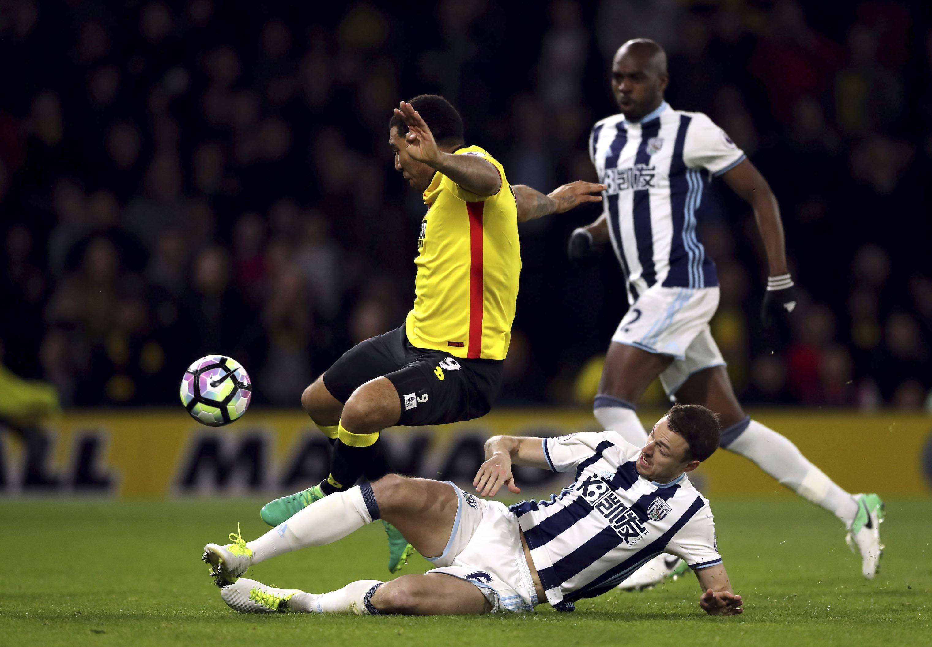 Watford's Troy Deeney, top, scores his side's second goal of the game against West Bromwich Albion during the English Premier League soccer match between Watford and West Brom at the Vicarage Road in Watford, England, on Tuesday April 4, 2017. Photo: AP