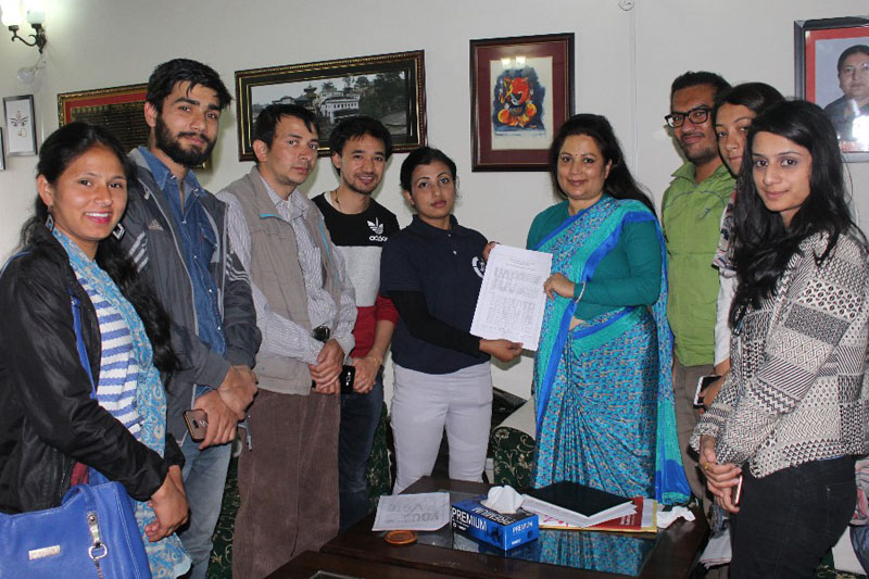 Youth activists submit a memorandum to Election Commissioner Ila Sharma in the run-up to the local level elections, at the Election Commission, in Kathmandu, on Friday, April 7, 2017. Photo courtesy: Deepak Sunuwar
