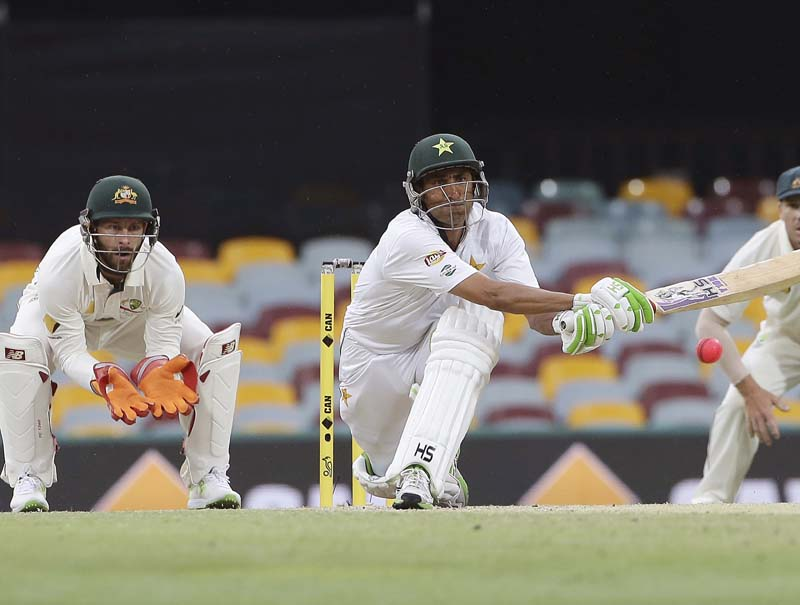 FILE - Pakistan's Younis Khan playing a reverse sweep shot as Australia's wicket keeper Matthew Wade looks on during play on day four of the first cricket test between Australia and Pakistan in Brisbane, Australia, Sunday, December 18, 2016. Photo: AP