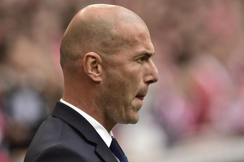 Real Madrid's head coach Zinedine Zidane watches the Spanish La Liga soccer match between Real Madrid and Athletic Bilbao, at San Mames stadium, in Bilbao, northern Spain, on Saturday, March 18, 2017. Photo: AP