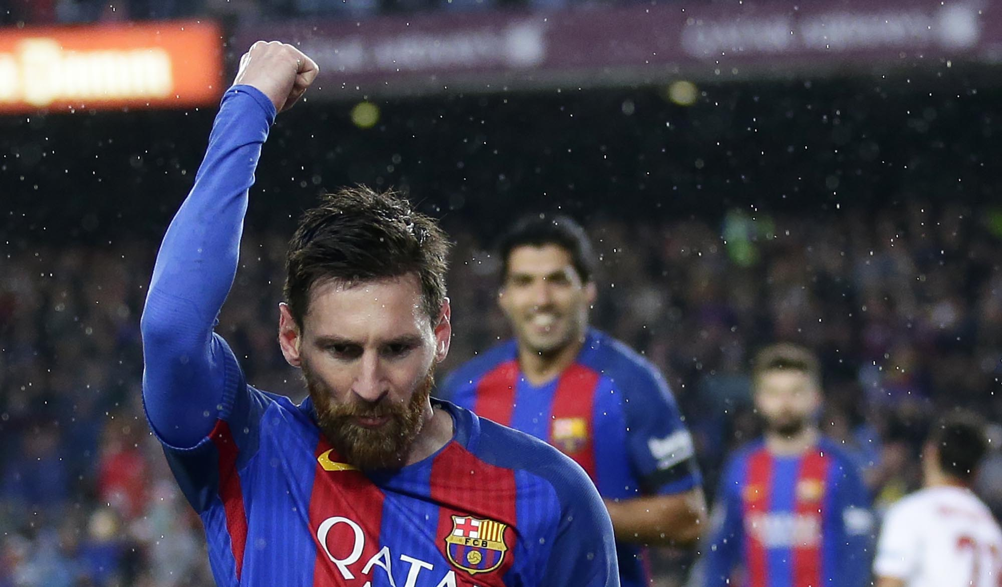 FC Barcelona's Lionel Messi celebrates after scoring during the Spanish La Liga soccer match between FC Barcelona and Sevilla at the Camp Nou stadium in Barcelona, Spain, on Wednesday, April 5, 2017. Photo: AP