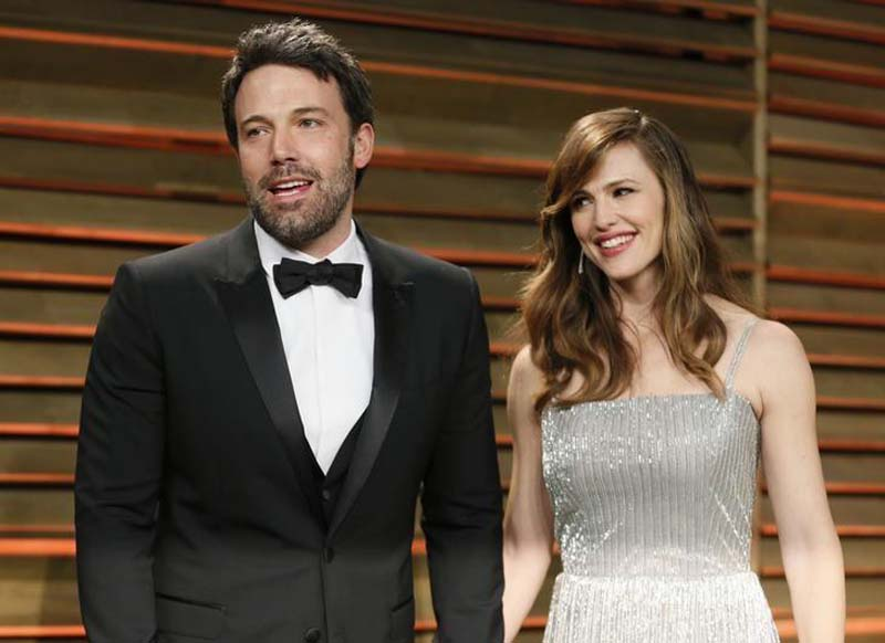 Actor Ben Affleck and his wife, actress Jennifer Garner arrive at the 2014 Vanity Fair Oscars Party in West Hollywood, California, on March 2, 2014. Photo: Reuters/File