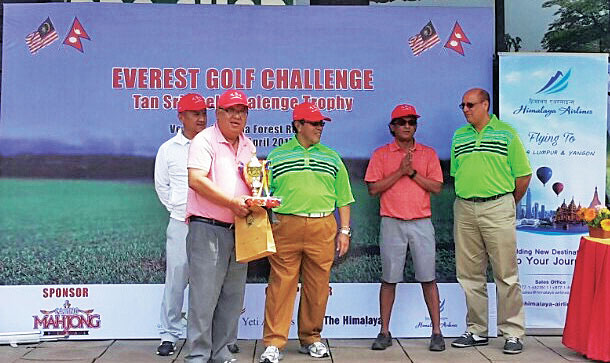Bijay Bahadur Shrestha holds the trophy after the Everest Golf Challenge on Saturday.
