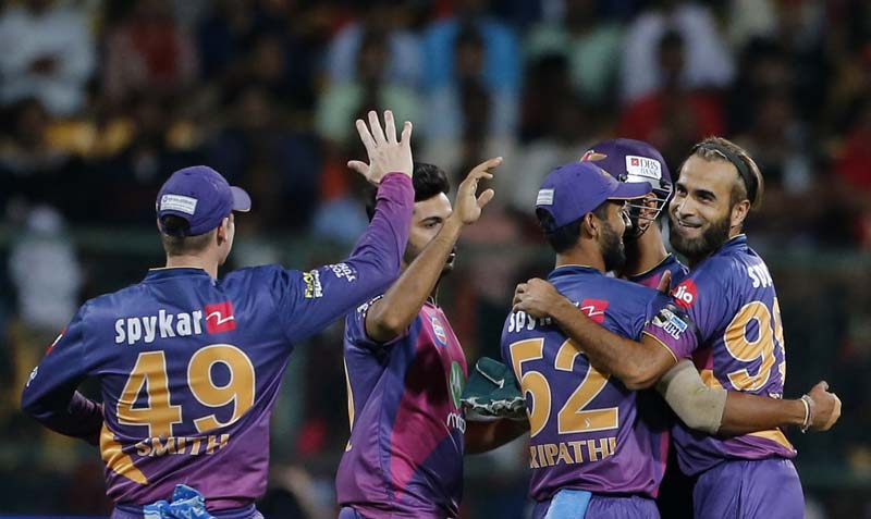 Rising Pune Supergiants bowler Imran Tahir (right), celebrates with teammates the dismissal of Royal Challengers Bangalore batsman AB de Villiers during their Indian Premier League (IPL) cricket match in Bangalore, India, on Sunday, April 16, 2017. Photo: AP