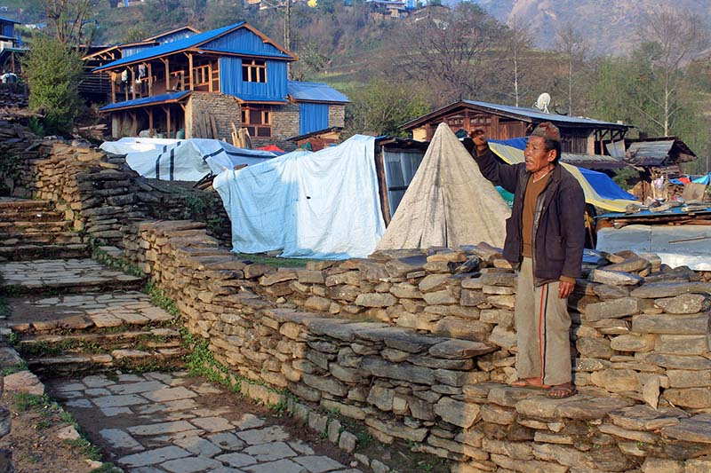 An elderly man, who works as a katuwal (a man who shouts to inform the village), informs locals of Gumda village about a cleanliness drive being launched, on Friday, April 7, 2017. People of Gumda still use the traditional way of communication. Photo: RSS