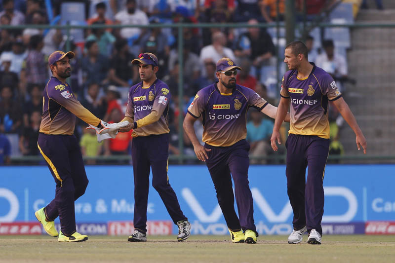 Kolkata Knight Riders' captain Gautam Gambhir, second left, Nathan Coulter Nile (right), and others celebrate the dismissal of Delhi Daredevils' Karun Nair during their Indian Premier League (IPL) cricket match in New Delhi, India, Monday, April 17, 2017. Photo: AP/File