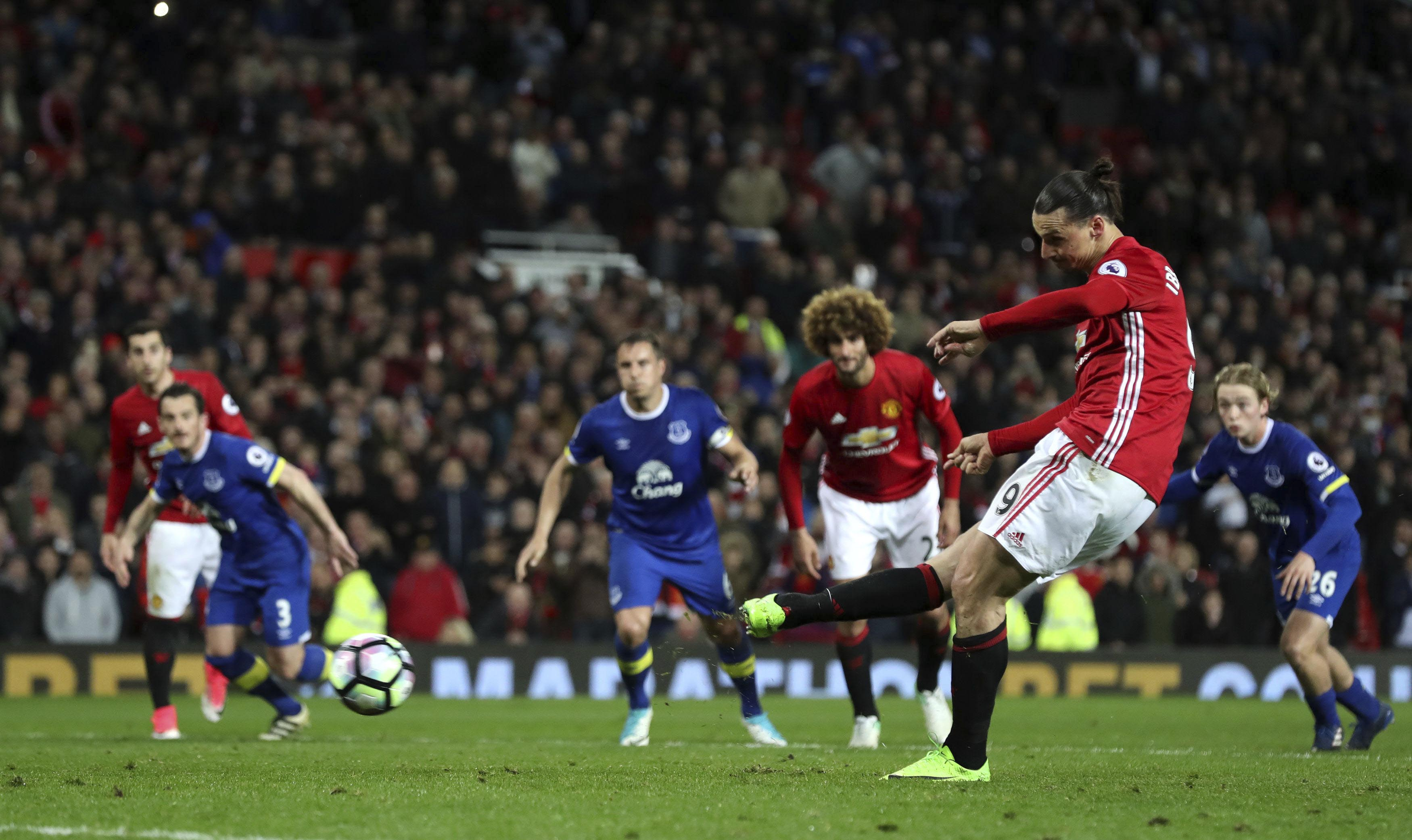 Manchester United's Zlatan Ibrahimovic scores from the penalty spot, against Everton during their English Premier League soccer match between Manchester United and Everton at Old Trafford in Manchester, England, on Tuesday April 4, 2017. Photo: AP