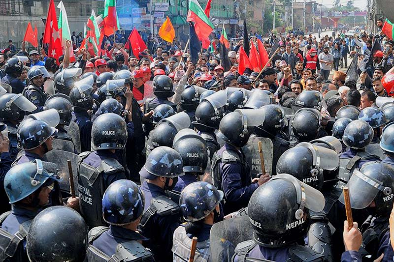 Police intercept leaders and cadres of Naya Shakti Party Nepal and other fringe parties, outside the Election Commission Office, in Jamal of Kathmandu, on Sunday, April 2, 2017. Photo Courtesy: Naya Shakti Party Nepal/Twitter
