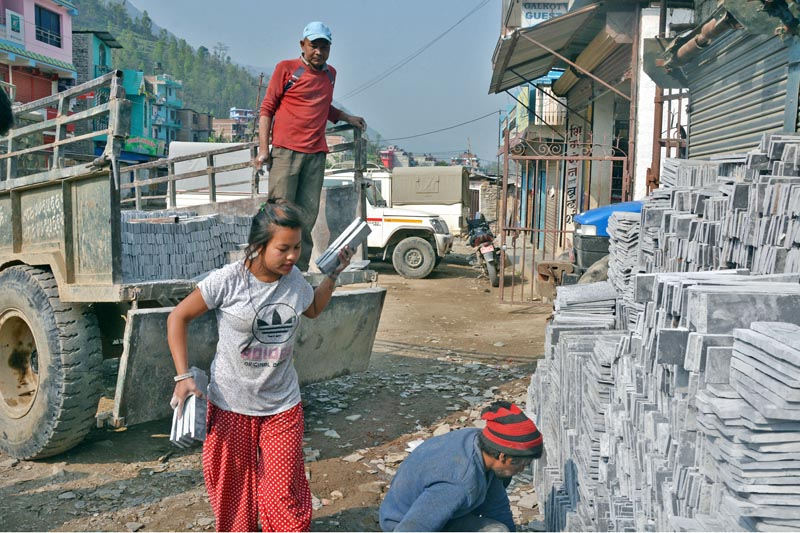 Workers unload slate stone brought from Tara River in Golkot Municipality, on Thursday, April 13, 2017. Photo: RSS
