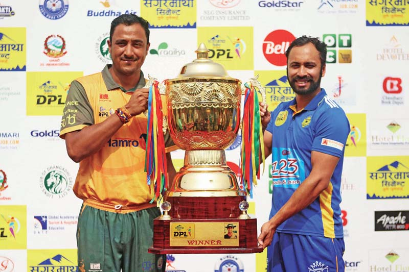 Dhangadhi Team Chauraha skipper Paras Khadka and his Biratnagar Kings counterpart Sharad Vesawkar (right) hold the trophy in Dhangadhi on Friday , on the eve of their Sagarmatha Cement DPL final match. Photo: Udipt Singh Chhetry