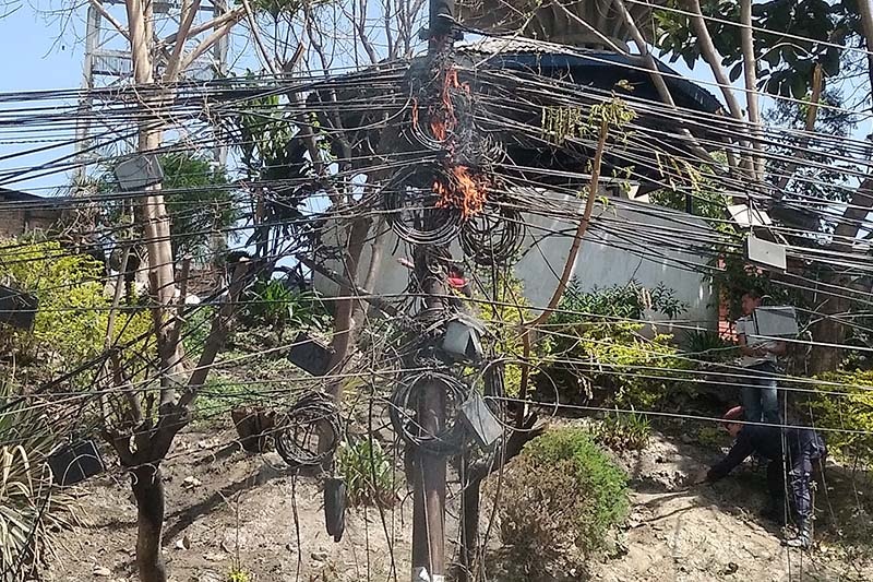 Another utility pole catches fire in a junction near New Plaza, Kathmandu, on Saturday, April 8, 2017. Photo: THT