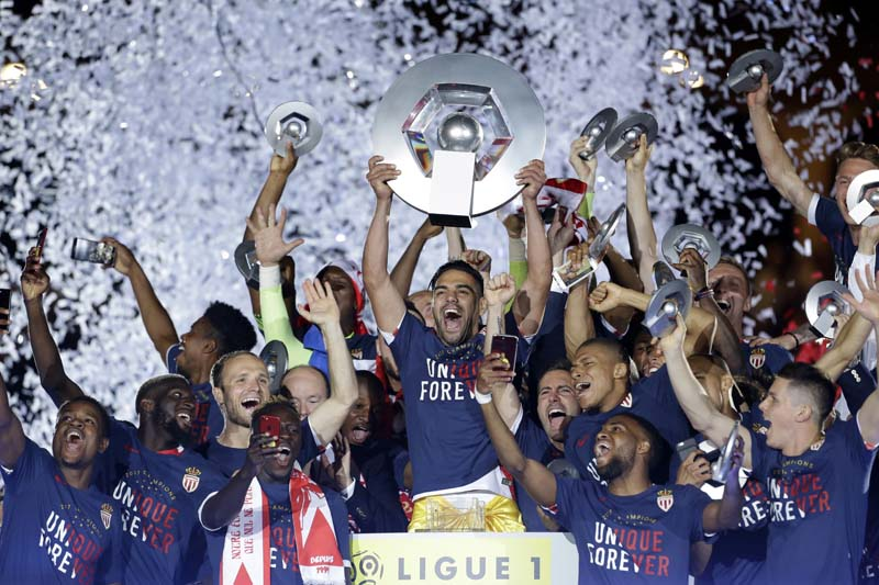 Monaco players celebrate their French League One title after beating Saint Etienne during the League One soccer match Monaco against Saint Etienne, at the Louis II stadium in Monaco, Wednesday, May 17, 2017. Photo: AP
