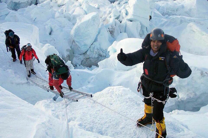 In this undated photo, Anita Kundu poses for the lens on Mt Everest region. Photo: Facebook