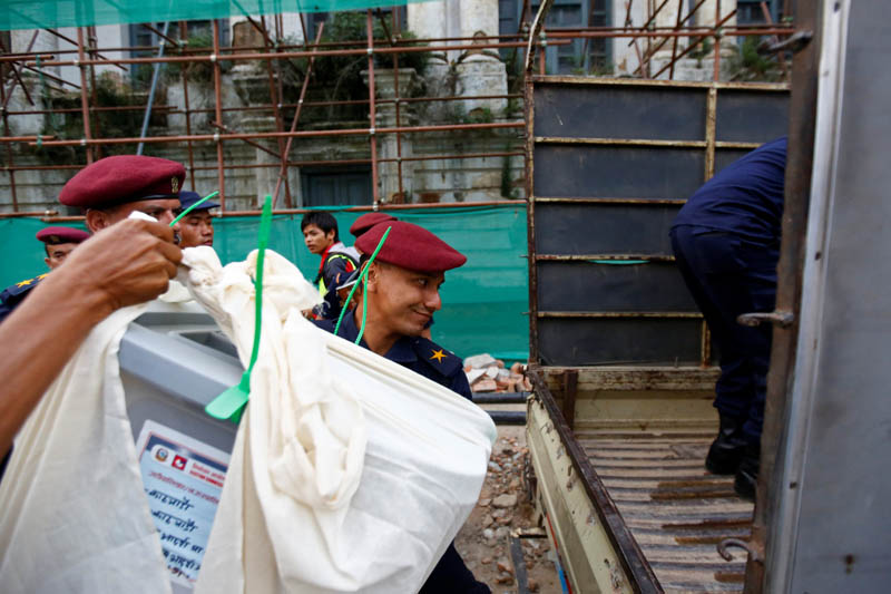 Nepali police men load sealed ballot boxes onto a vehicle, after the completion of the local election of municipalities and villages representatives in Kathmandu, Nepal May 14, 2017. Photo: Reuters