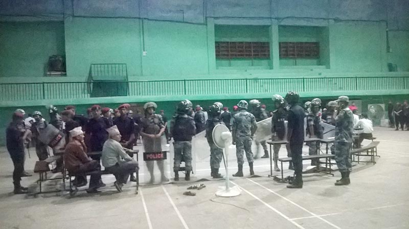 Security personnel guarding ballot papers at the counting centre where ballot papers in a covored hall where ballot papers were torn while counting votes for Bharatpur Metropolitan City, in Chitwan district, on Sunday, May 28, 2017. Photo: Tilak Ram Rimal/THT Online