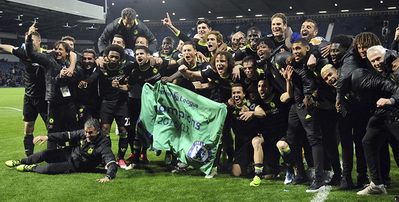 Chelsea's players and staff celebrate after the English Premier League soccer match between West Bromwich Albion and Chelsea, at the Hawthorns in West Bromwich, England, on Friday, May 12, 2017. Chelsea won the match 0-1 meaning they win the Premiership title. Photo: AP