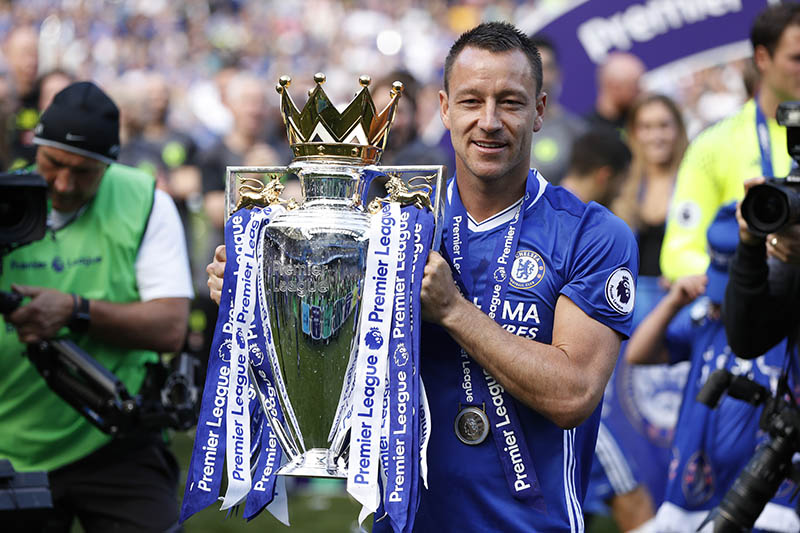 Chelsea's John Terry celebrates with the trophy after winning the Premier League. Photo: Reuters