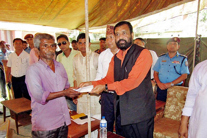 DPM Nidhi hands over cheque to the Saptari incident victim's family member in Rajbiraj on Wednesday, May 17, 2017. Photo: Ramjee Dahal