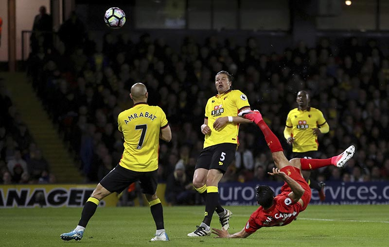 Liverpool's Emre Can scores against Watford during the English Premier League soccer match at Vicarage Road, London, on Monday, May 1, 2017. Photo: John Walton/PA via AP