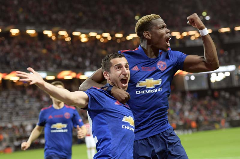 Manchester United's Henrikh Mkhitaryan, (left), celebrates scoring with teammate Paul Pogba during the  Europa League soccer final match between Ajax and Manchester United at the Friends Arena in Stockholm, Sweden, on Wednesday,  May 24, 2017. Photo: Anders Wiklund/TT via AP