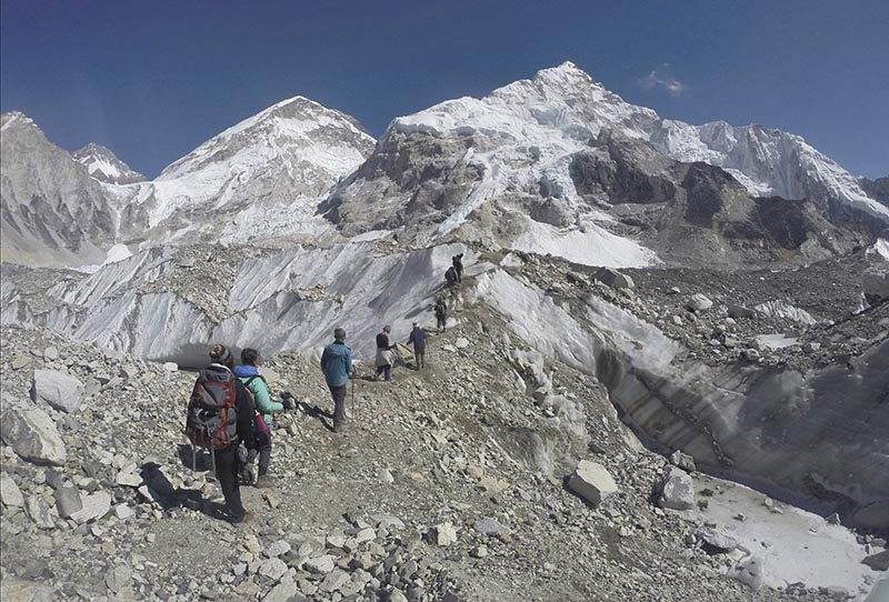 FILE - Trekkers pass through a glacier at the Mount Everest Base Camp, Nepal, on February 22, 2016. Photo: AP