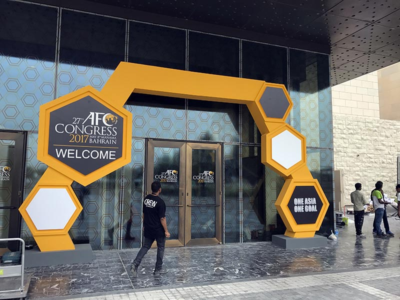 A member of staff walks towards the building hosting the AFC, Asian Football Confederation Congress 2017, in Manama, Bahrain, on Sunday, May 7, 2017. Photo: AP