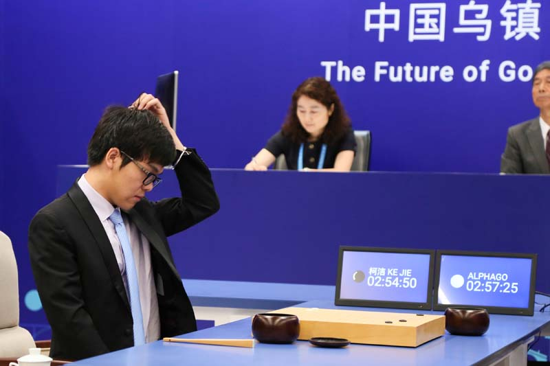 Chinese Go player Ke Jie reacts during his first match with Google's artificial intelligence program AlphaGo at the Future of Go Summit in Wuzhen, Zhejiang province, China, on May 23, 2017. Photo: Reuters