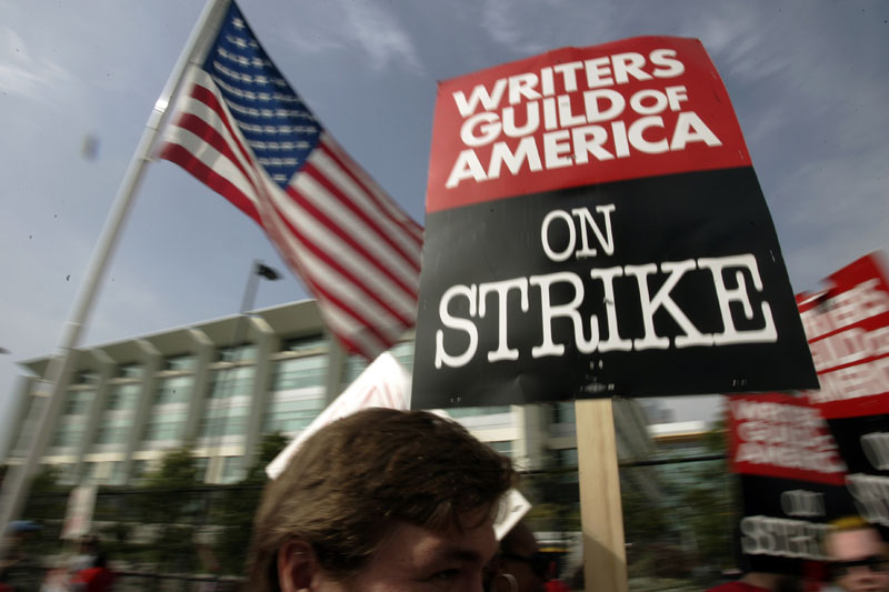Writers Guild of America (WGA) writers and others strike against the Alliance of Motion Picture and Television Producers (AMPTP) in a rally at Fox Plaza in Los Angeles' Century City district, on November 9, 2007. Photo: AP/File