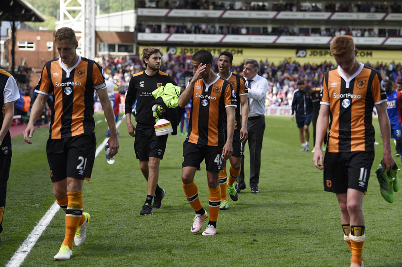 Hull City's Evandro Goebel and team mates look dejected after the match. Photo: Reuters