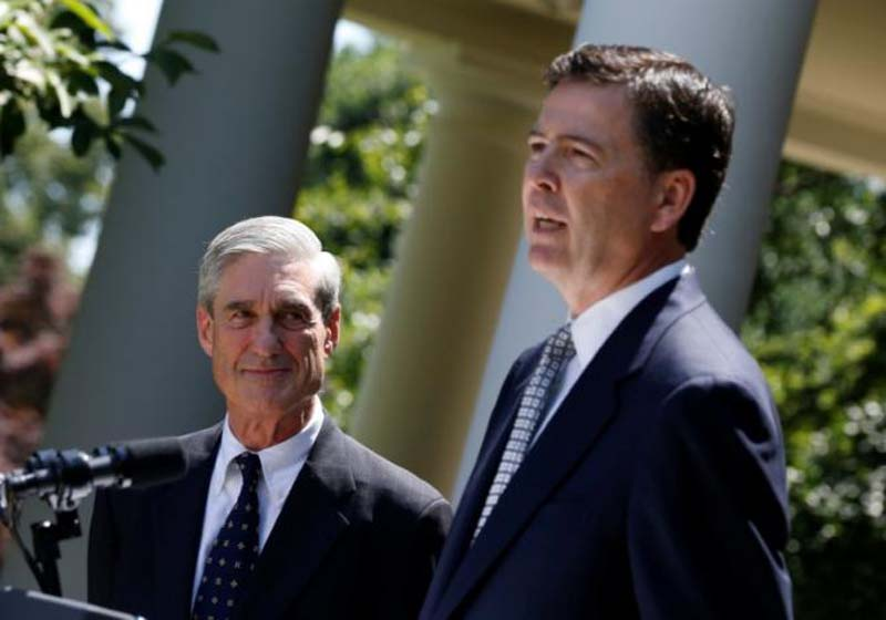 James Comey (right), a Republican who served in the Bush Justice Department, speaks alongside outgoing FBI Director Robert Mueller after being nominated by US President Barack Obama (not pictured) to replace Mueller, in the Rose Garden of the White House in Washington, on June 21, 2013. Photo: Reuters/File