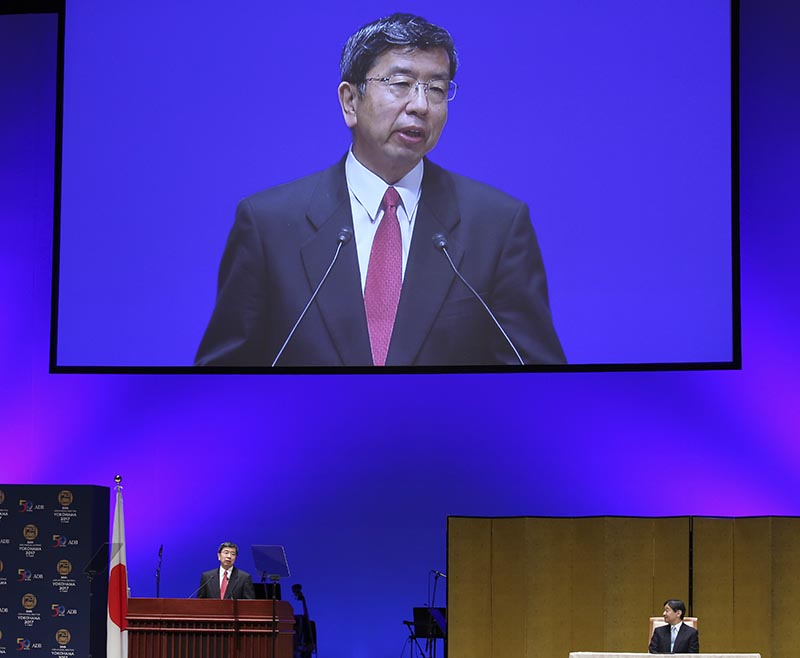 Asian Development Bank President Takehiko Nakao (left) delivers a speech as Japanese Crown Prince Naruhito listens during the opening session of the ADB board of governors in Yokohama, on Saturday, May 6, 2017. Photo: AP