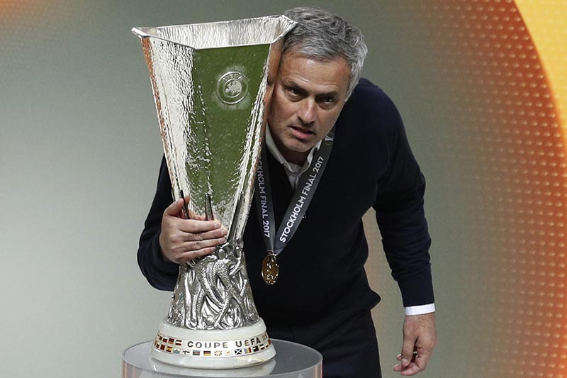 Manchester United manager Jose Mourinho with the tophy. Photo: Reuters