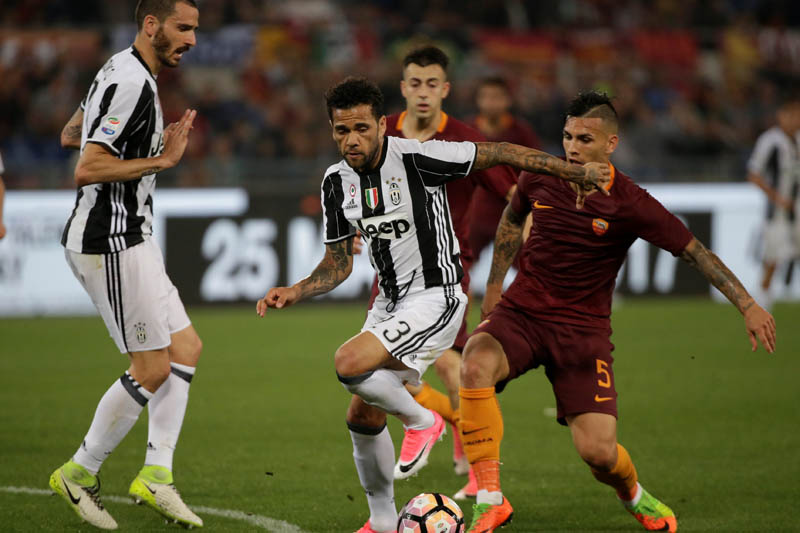 Romau2019s Leandro Paredes in action with Juventusu2019 Dani Alves. Photo: Reuters