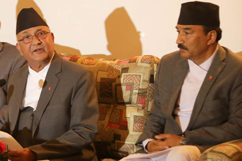 Prime Minister KP Sharma Oli (left) speaks with journalists upon his arrival at the Tribhuvan International Airport from an official China visit, in Kathmandu, on Sunday, March 27, 2016. Photo: RSS