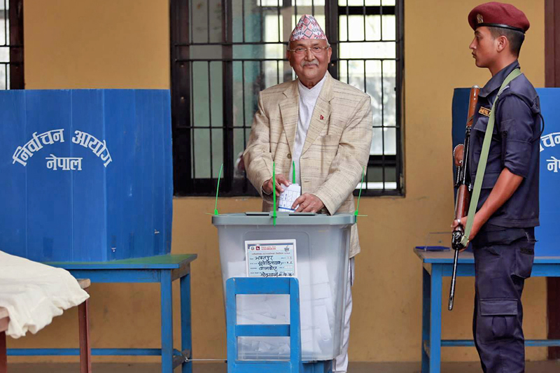 The CPN-UML Chairman KP Sharma Oli casts his vote at a polling centre in Balkot of Suryabinayak Municipality, Bhaktapur, on Sunday, May 14, 2017. Photo: RSS