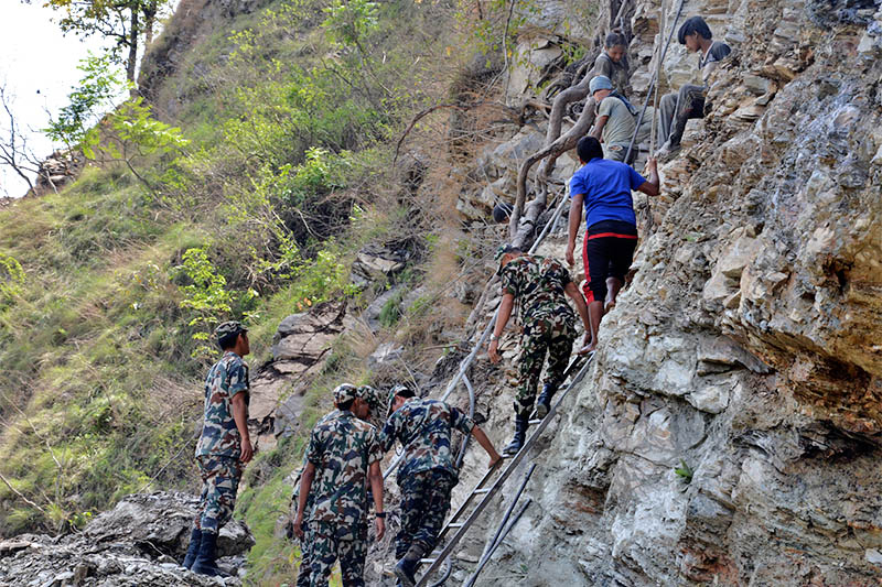 Nepali Army personnel are seen working at a ciff, without any minimum saftety measures, for the construction of Kaligandai corridor road at Jaimani Municipality-5, in Baglung district, on Thursday, May 4, 2017. Photo: RSS