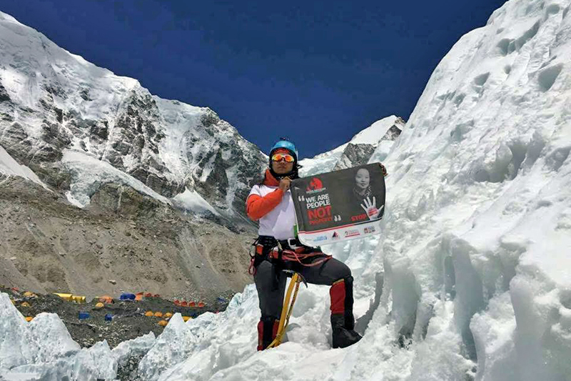 FILE- In this undated photo, Kanchhi Maya Tamang poses for the camera on Mt Everest. Photo: Facebook