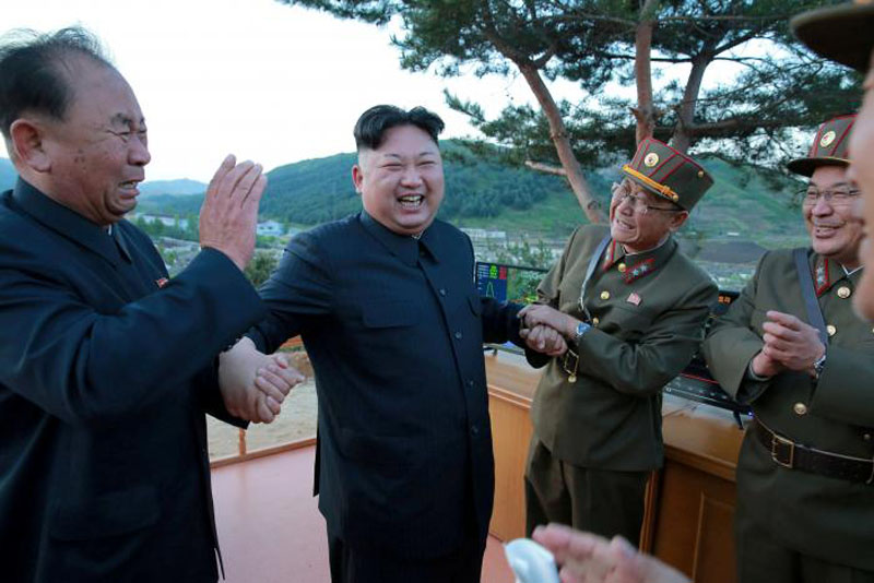 North Korean leader Kim Jong Un reacts with Ri Pyong Chol (left) in this undated photo released by North Korea's Korean Central News Agency (KCNA) on May 15, 2017. Photo: Reuters