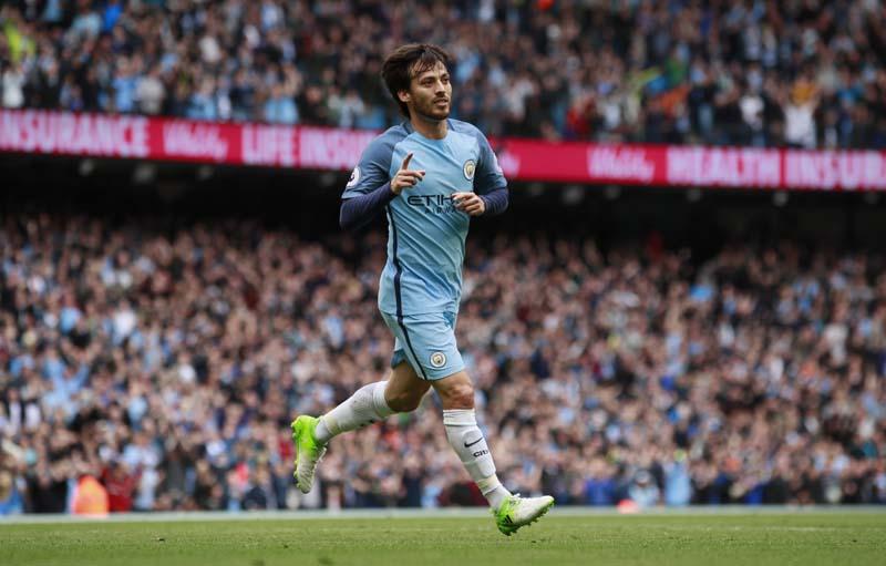 Manchester City's David Silva celebrates scoring their first goal. Photo: Reuters