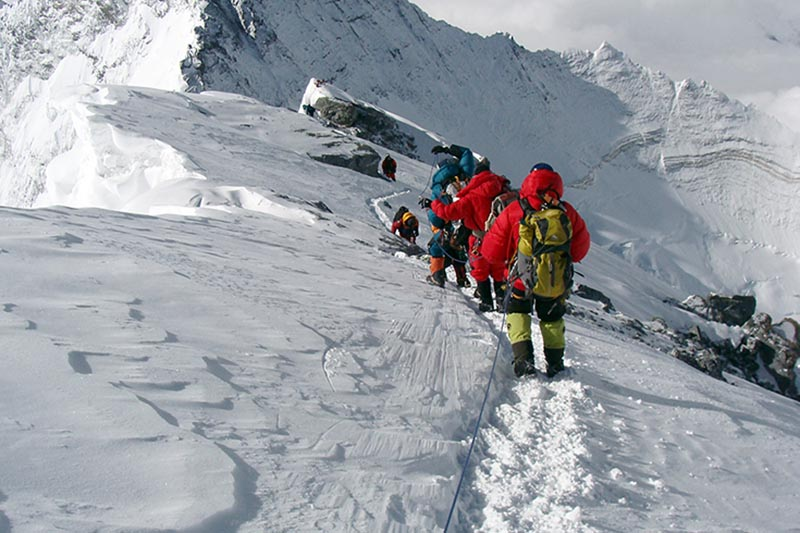 Mountaineers are seen descending Mt Everest. Courtesy: Dean Smith