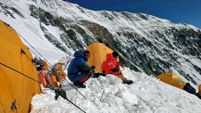 In this undated photo, climbers rest at an altitude of 7000 m in north side of the Mt Everest. Photo courtesy: Arnold Coster