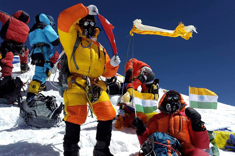 In this undated photo, climbers pose for a photograph on their way to Mt Everest. Photo Courtersy: Rishi Bhandari