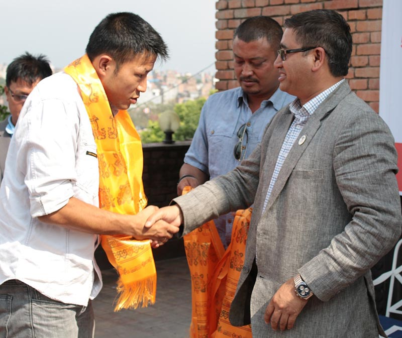National basketball team skipper Sadish Pradhan (left) shakes hands with Nepal Olympic Committee President Jeevan Ram Shrestha during a farewell programme in Kathmandu on Tuesday, May 16, 2017. Photo: THT