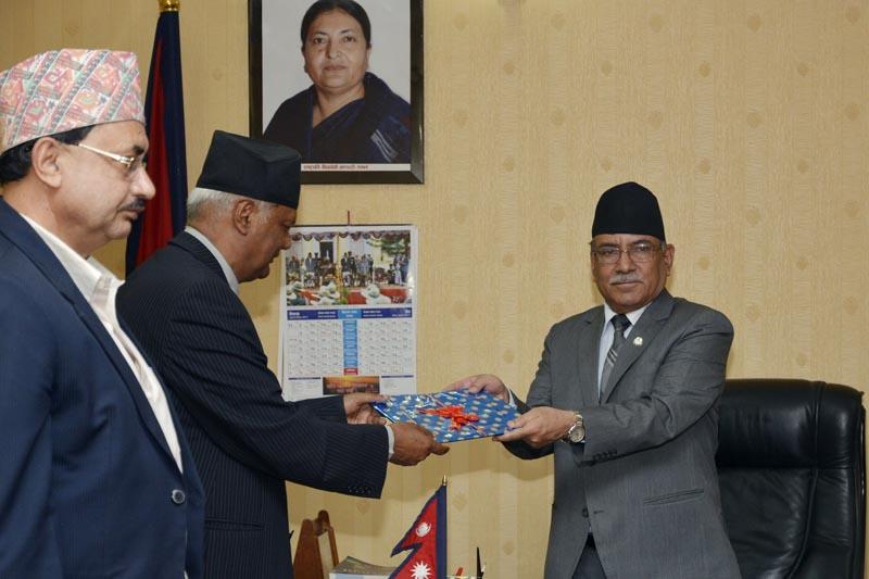 Academy Chancellor Ganga Prasad Upreti presenting annual budget of Nepal Academy to Prime Minister Pushpa Kamal Dahal on May 12, 2017. Photo: PM's Secretariat