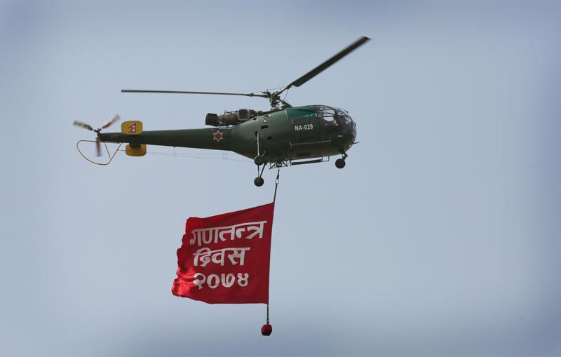 A Nepal Army helicopter hovers with a banner of Republic Day 2016 above Tundikhel during a special function organised to mark the 10th Republic Day in Kathmandu, on Monday, May 29, 2017. Photo: Rajesh Gurung