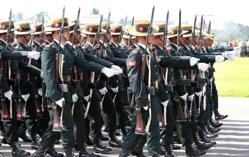 FILE - Nepali Army personnel participate in a march-past during a special function organised to mark the 10th Republic Day at the Army Pavilion, Tundikhel,  in Kathmandu, on Monday, May 29, 2017. Photo: Rajesh Gurung